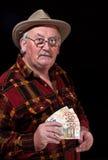 tła czarny zagadnień męski pieniądze senior Fotografia Royalty Free