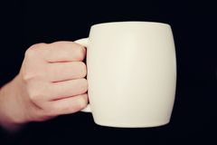 tła czerń filiżanki ręki odosobniony biel Zdjęcie Stock
