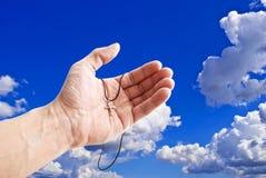tła krzyża otwarty palmowy niebo Obraz Stock