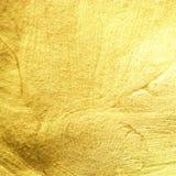tła krzyw ramowa złocista makro- stara tekstura Złota folia jako abstrakt textured tło Iść fotografia royalty free