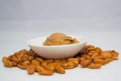 tła masła kropli oleju arachidu stylizowany biel Obrazy Royalty Free