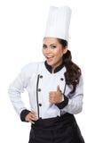 tła piekarnianego rozochoconego szef kuchni kucharza żeńscy szczęśliwi kapeluszowi odosobneni uśmiechnięci kciuki mundurują w gór Zdjęcia Royalty Free