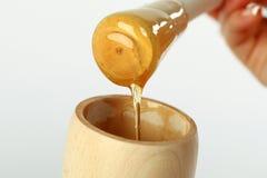 tła pszczoły chochli szklany miodowy honeycomb honeycombs słoju smacznego kąska wosk Miodowy smaczny kąsek w szklanym słoju i hon Obraz Royalty Free