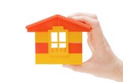 tła ręki dom odizolowywający zabawkarski biel fotografia stock