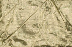 tła tkaniny złoto Fotografia Stock