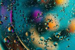 tło abstrakcyjna przestrzeni Wod krople różni colours Obrazy Royalty Free