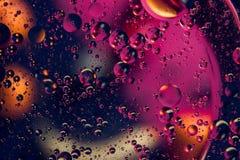 tło abstrakcyjna przestrzeni Wod krople różni colours Zdjęcia Royalty Free