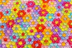 Tło barwioni koraliki, tło kwiaty robić barwioni koraliki Fotografia Royalty Free
