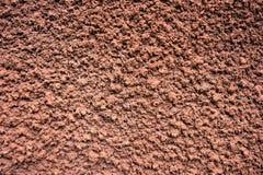 Tło brown dekoracyjnego tynku obdarty szorstki wypukły obrazy royalty free