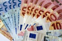 Tło euro rachunki Czas w pieniądze Obrazy Stock