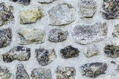 Tło kamienie na cement ścianie struktura Zdjęcia Royalty Free