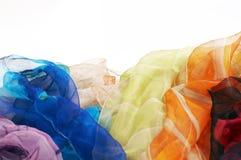 tło kolorowych szali biały jedwab, Obraz Stock