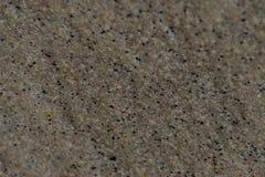 Tło mokry i błyszczący piasek zamknięty w górę zdjęcie stock