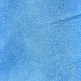 Tło niebiescy dżinsy Obrazy Stock