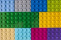Tło niektóre różni koloru Lego baseplates Zdjęcia Stock