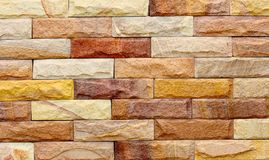 Tło nowożytna kamienna ceglana tekstura, abstrakcjonistyczna piaska lub granitu ściana Obrazy Royalty Free