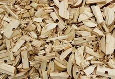 Tło od trocinowych drewnianych goleń Zdjęcie Stock