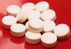 tło pigułek narkotyków czerwony błyszczący white Obrazy Royalty Free