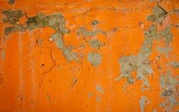 Tło pomarańczowa stiuk powierzchowność, szorstka obsada cement i betonowej ściany tekstura pokrywająca i malująca, dekoracyjny ni Fotografia Stock