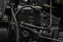 Tło powierzchnia stary, czarny i wazeliniarski maszynowy silnik, fotografia royalty free
