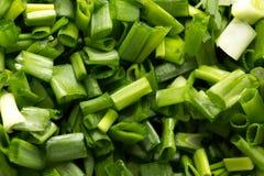 Tło siekać zielone cebule Makro- Obrazy Stock