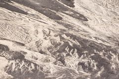 Tło tekstury czarny i biały piasek deseniowa natura Lanzarote Obrazy Stock