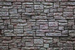 Tło, tekstury kamienna dekoracyjna ściana Obrazy Royalty Free