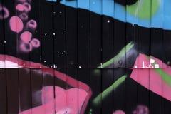 Tło wizerunek z graffiti elementami Tekstura ściana, malująca w różnych kolorach w graffiti projektuje pojęcie str Obraz Royalty Free