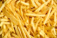 Tło wyśmienicie żółte grule french ścinku fry obraz wyizolowanego drogę Fast food zdjęcia royalty free