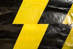 Tło zmięta żółta ochronna taśma obraz stock