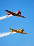 T-6 Texan Formation in Flight. A fromation of T-6 Texan World War 2 Airplanes passes by with smoke on at the 2010 Denton, Texas Airshow royalty free stock photo