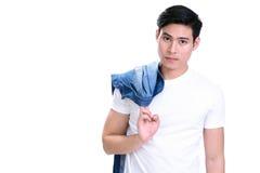 年轻英俊的亚裔人画象白色T恤杉的 免版税库存图片