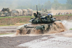 T-90 tank crossing water obstacle Stock Photos