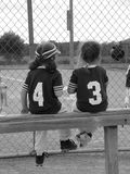 T-ball girls 2. Two girl t-ball players on the bench in black and white Stock Photo