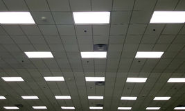 T Bar ceiling with fluorescent light box. And air conditioner grille Stock Image