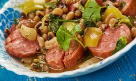 T Black-Eyed Pea Stew With Kale. Hearty One-Pot Black-Eyed Pea Stew With Kale and Andouille ,  Cajun cuisine Royalty Free Stock Photography