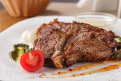 T- Bone Steak. T- Bon Steak with mushroom and pepper sauce stock photos