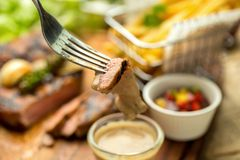 T-Bone Beef Steak on wooden board.  Beef Steak Dinner and French. Fries Stock Image