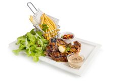T-Bone Beef Steak on wooden board.  Beef Steak Dinner and French. Fries Stock Images