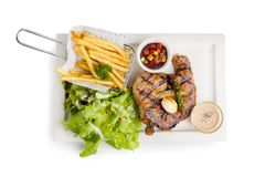 T-Bone Beef Steak on wooden board.  Beef Steak Dinner and French. Fries Royalty Free Stock Images