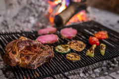T-bone or florentine steak on a charcoal grill. Tenderloin steak on a charcoal (wooden) grill Royalty Free Stock Photos