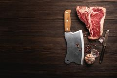 T-bone and meat cleaver stock images