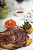 T-Bone-Steak. Closeup of a T Bone Steak on a plate Royalty Free Stock Images
