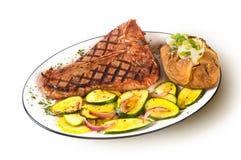 T-Bone Steak. A grilled T-Bone steak on white Stock Photo