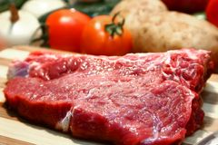 T-bone steak. Being prepared for cooking Royalty Free Stock Photos