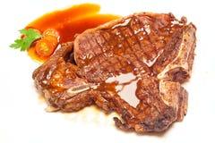 T-bone steak. On white background Royalty Free Stock Image