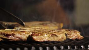 T-bone Steak on Barbecue grill at restaurant. T-bone Steak on Barbecue grill stock video