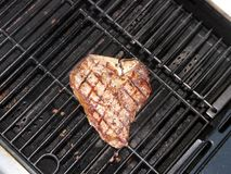 T-bone steak being grilled stock photography