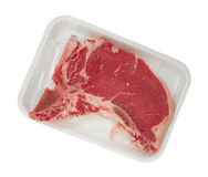 T-bone steak in butcher's foam tray Royalty Free Stock Photography