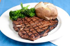 T-bone steak. A delicious t-bone steak grilled to perfection Royalty Free Stock Photo